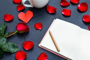 Red rose with heart shape photo