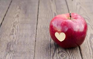 apple with a symbol heart photo
