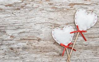 Textile hearts on old wood photo