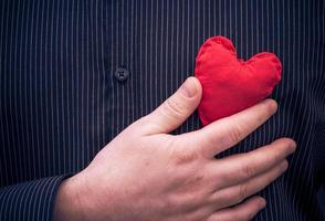 closeup red heart hand man
