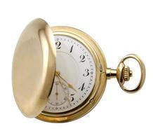 reloj dorado.