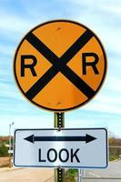 Stop sign and private railroad notice sign. photo