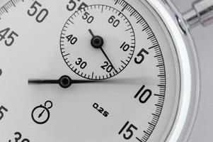 Stopwatch closeup. With a moving arrow