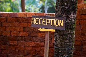 """Wooden sign with the word """"reception"""" photo"""