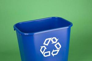 Recycling bin on green background photo