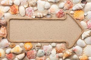 Pointer made of rope with seashells photo