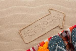 Montenegro  pointer and beach accessories lying on the sand