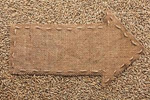 Pointer of burlap with place for your text, lying  rye