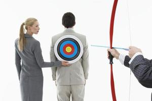 Aiming Arrow At Target On Businessman's Back photo
