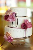 decorative wedding cake at wedding reception.