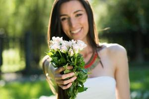 young woman giving bouquet of flowers
