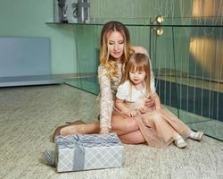 Mother, daughter and a gift for holiday photo