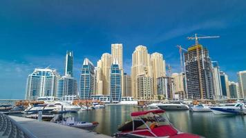 Timelapse hyperlapse of business city in Dubai marina at waterfront