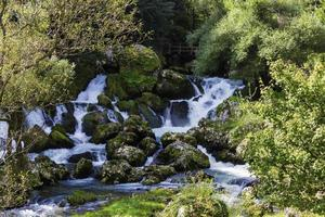 Cascade waterfalls with lot of rocks photo