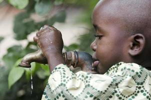 Little Black Man Begging for Clean Fresh Water Africa