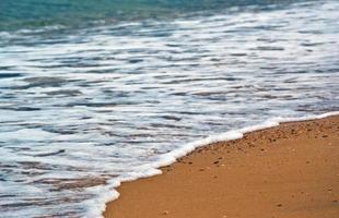 Sea wave splash on the beach sand