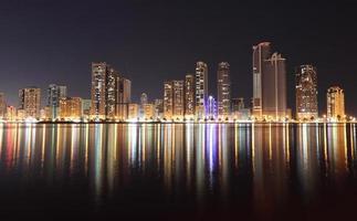 Skyline of Sharjah City at night photo