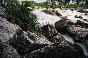 giant rocks in a waterfall, long exposure