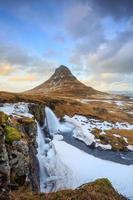 Beauty of Kirkjufell mountain with water falls photo