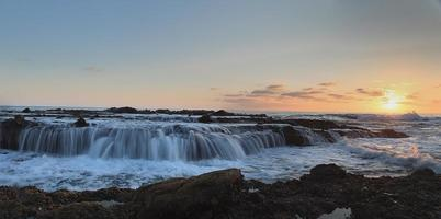 Panoramic Victoria beach rocks with water flowing