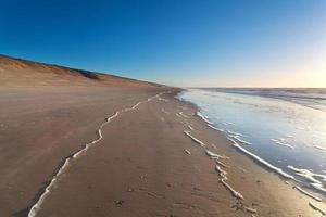 sand beach and North sea waves photo