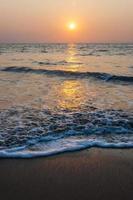 Sunset sun above the Arabian sea beach in Kochi, India.