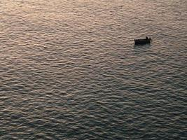 sea and small boat photo