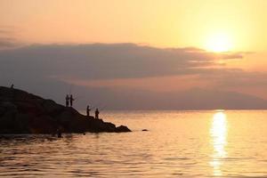 siluetas de pescadores