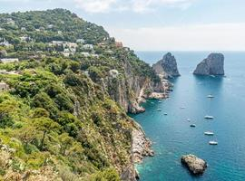 Above Capri Island and Faraglioni boats - Amalfi, Italy