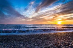 Bright Sunset and Waves photo