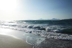 Sun and sea waves photo