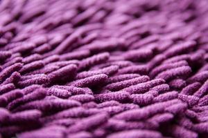 textura de alfombra morada foto