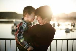 Sunset water front mother & son photo