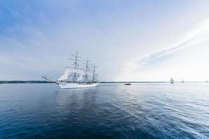 Tall ship on blue water horizontal photo