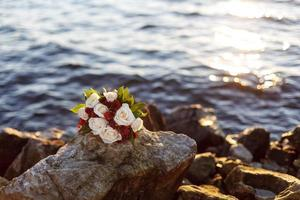 bouquet of flowers near the water photo