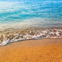 Sand beach and wave photo