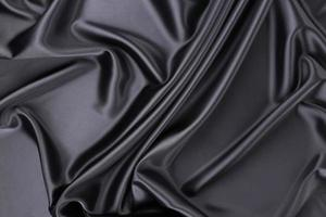 Black silk background. Texture.