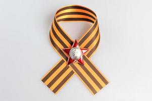 Saint George ribbon with Order of  Red star on gray photo