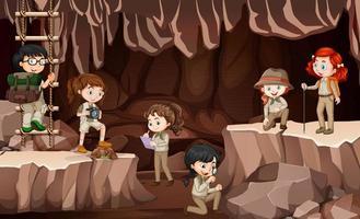 escena con grupo de exploradores explorando una cueva. vector