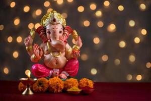 Hindu God Ganesha on blurred bokeh background