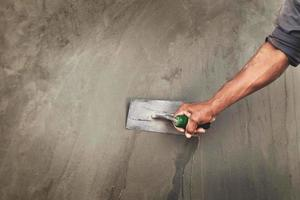 Plastering a concrete wall
