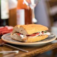 Tasty sandwich with red wine