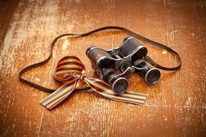 Vintage military binoculars and George Ribbon