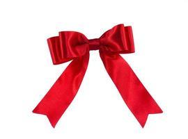 Shiny red ribbon on white background. photo