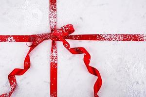 Marble Pastry Board wrapped in Red Ribbon with confectioners sugar photo