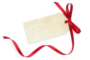 Blank gift tag with red ribbon on white background