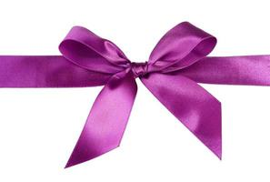 Purple satin bow tied with care over a white background