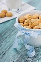 Cookies with blue ribbon and milk