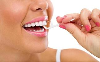 woman cleaning flossing photo