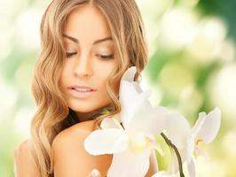 beautiful woman with orchid flower photo